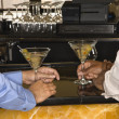 Men at martini bar. — Stock Photo