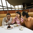 Friends eating dessert. — Stock Photo