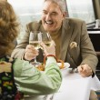 Mature couple toasting. — Stock Photo