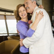 Stock Photo: Mature couple embracing.