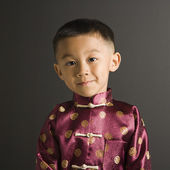 Asian boy in traditional costume. — Stock Photo
