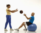 Woman and man exercising. — Stock Photo