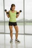 Female lifting dumbbells. — Stock Photo