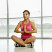Woman in lotus posture. — Stock Photo