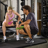 Woman lifting weights. — Stock Photo