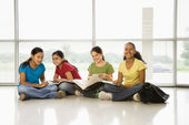 Girls doing schoolwork. — Stock Photo