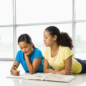 Girls doing schoolwork. — Stockfoto