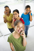 Girls on cell phones. — Stock Photo