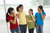 Girls on phones. — Stock Photo