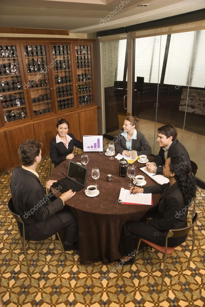 High angle of diverse group of businesspeople in meeting.  Stock Photo #9255140