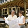 Couple Holding Building Plans — Stock Photo