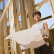 Woman Holding Building Plans — Stock Photo #9276905