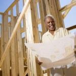 Man Holding Building Plans — Stock Photo