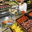 Woman grocery shopping. - Stock Photo