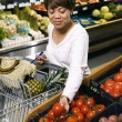 Woman grocery shopping. — Stok fotoğraf