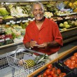Man grocery shopping. — Stock Photo #9276925