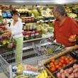 Stok fotoğraf: Couple grocery shopping.