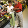 Couple in supermarket. - Stock Photo