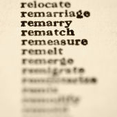 List of words in alphabetical order including words remarry and rematch. — Stock Photo