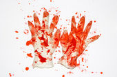 Blood covered rubber gloves. — Stock Photo