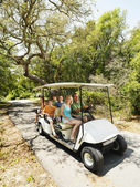 Family in golf cart. — Stock Photo
