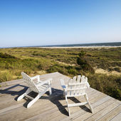 Deck chairs on beach. — Stock Photo