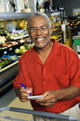 Man with grocery list. — Stock Photo