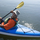 Happy man kayaking. — Stock Photo