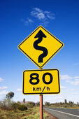 Speed limit curve ahead sign — Stock Photo