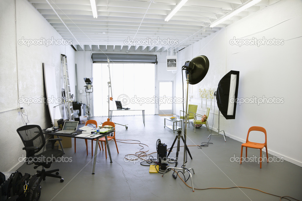 Interior of  photography studio with lights and various equipment and props.  Stock Photo #9275666
