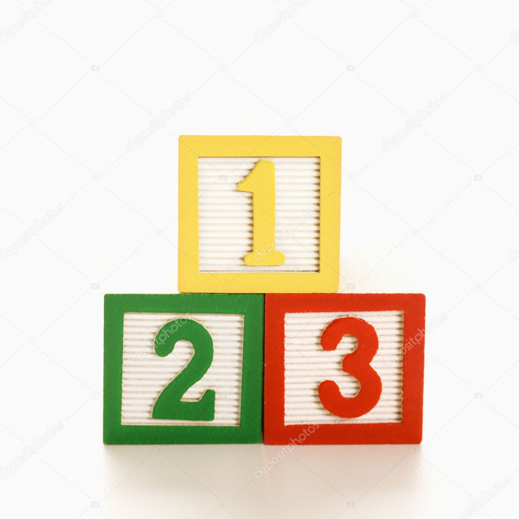 Numbered toy blocks in a stack. — Stock Photo #9275946