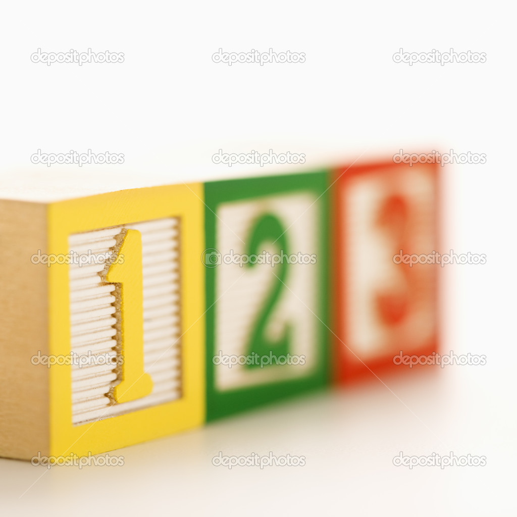 Selective focus of fow of toy building blocks with numbers.  Stock Photo #9275953