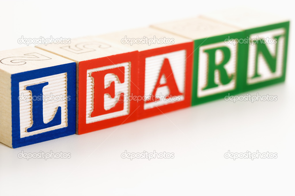 Alphabet toy building blocks spelling the word learn. — Stock Photo #9276038