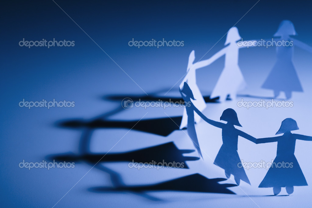 Cutout paper females standing holding hands. — Stock Photo #9276381