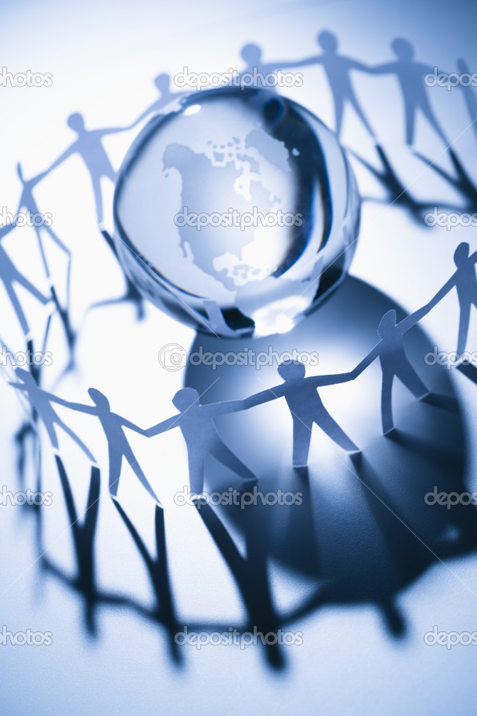 Cutout paper standing around globe holding hands.  Stock Photo #9276439