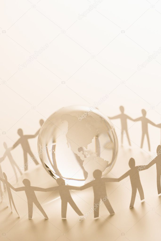 Cutout paper standing around globe holding hands.  Stock Photo #9276452