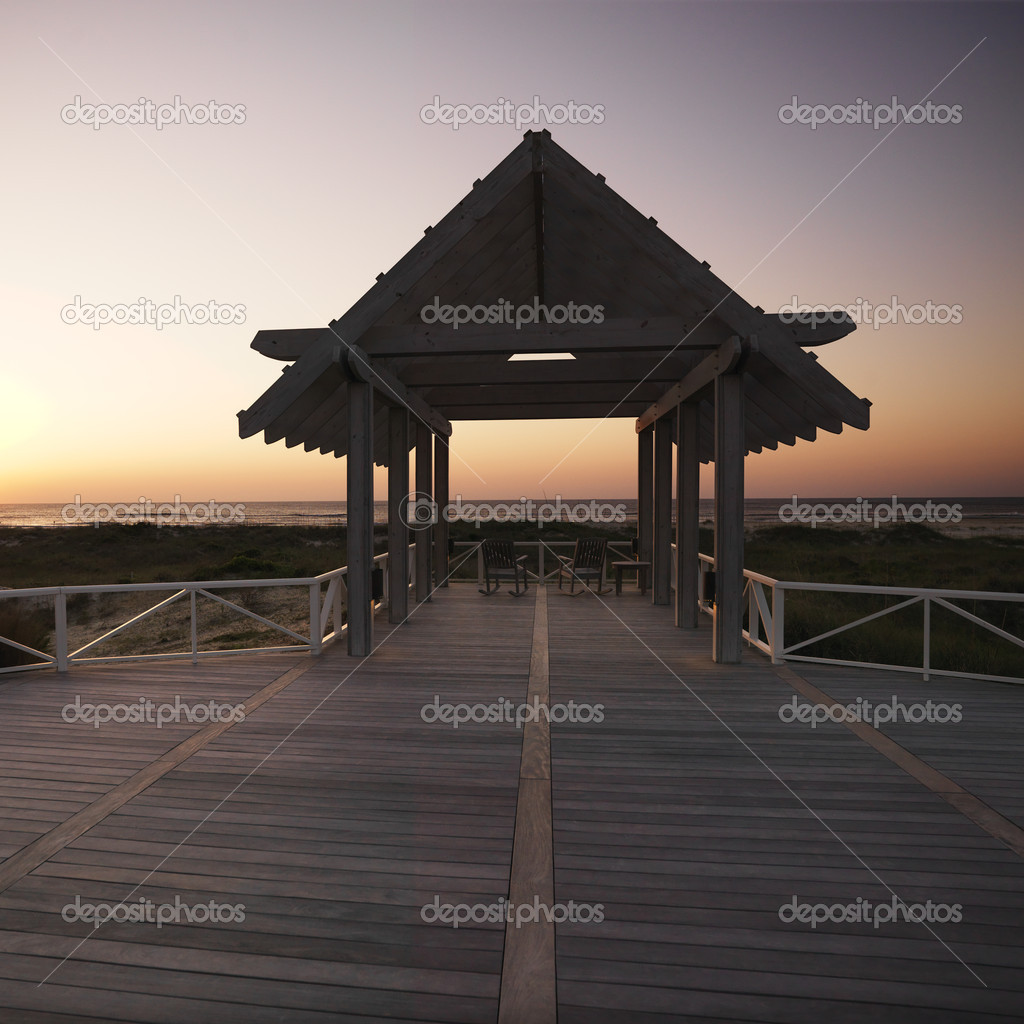 Gazebo at North Carolina coast with setting sun in background. — Stock Photo #9276633
