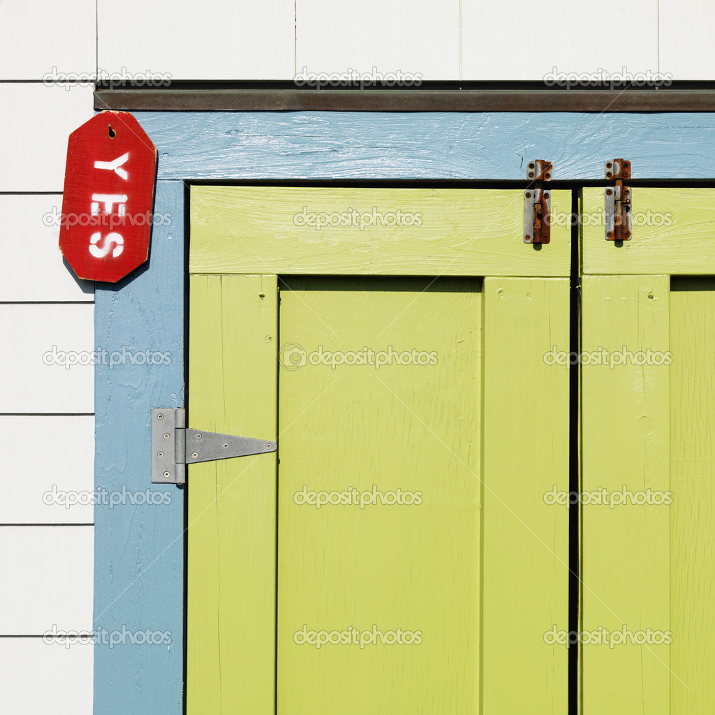 Detail of colorful doors with sign reading yes at Bald Head Island, North Carolina.  Stock Photo #9276752