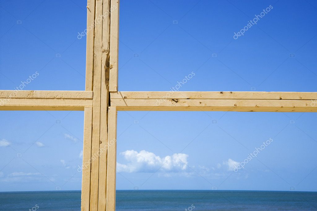 Ocean and sky behind new construction framed window. — Stock Photo #9277158