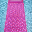 Pink float in  pool. — Stock Photo