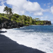 Black sand beach in Maui. — Stock Photo