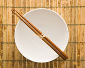 Chopsticks on an Empty Bowl — Stock Photo
