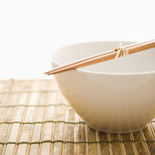 Chopsticks on an Empty Bowl. Isolated — Stock Photo