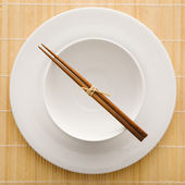 Chopsticks With Empty Bowl and Plate — Stock Photo