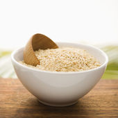 Grain in a White Ceramic Bowl. Isolated — Stock Photo
