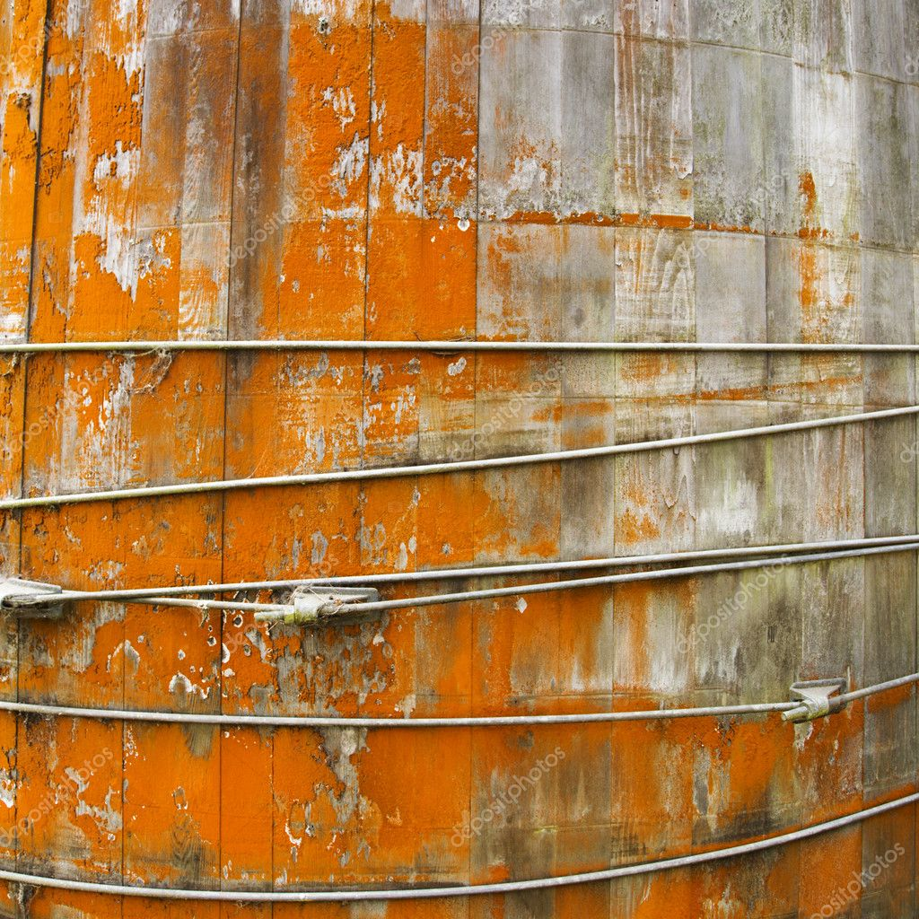 Close up of round structure with wood panels and peeling orange paint. — Stock Photo #9280522