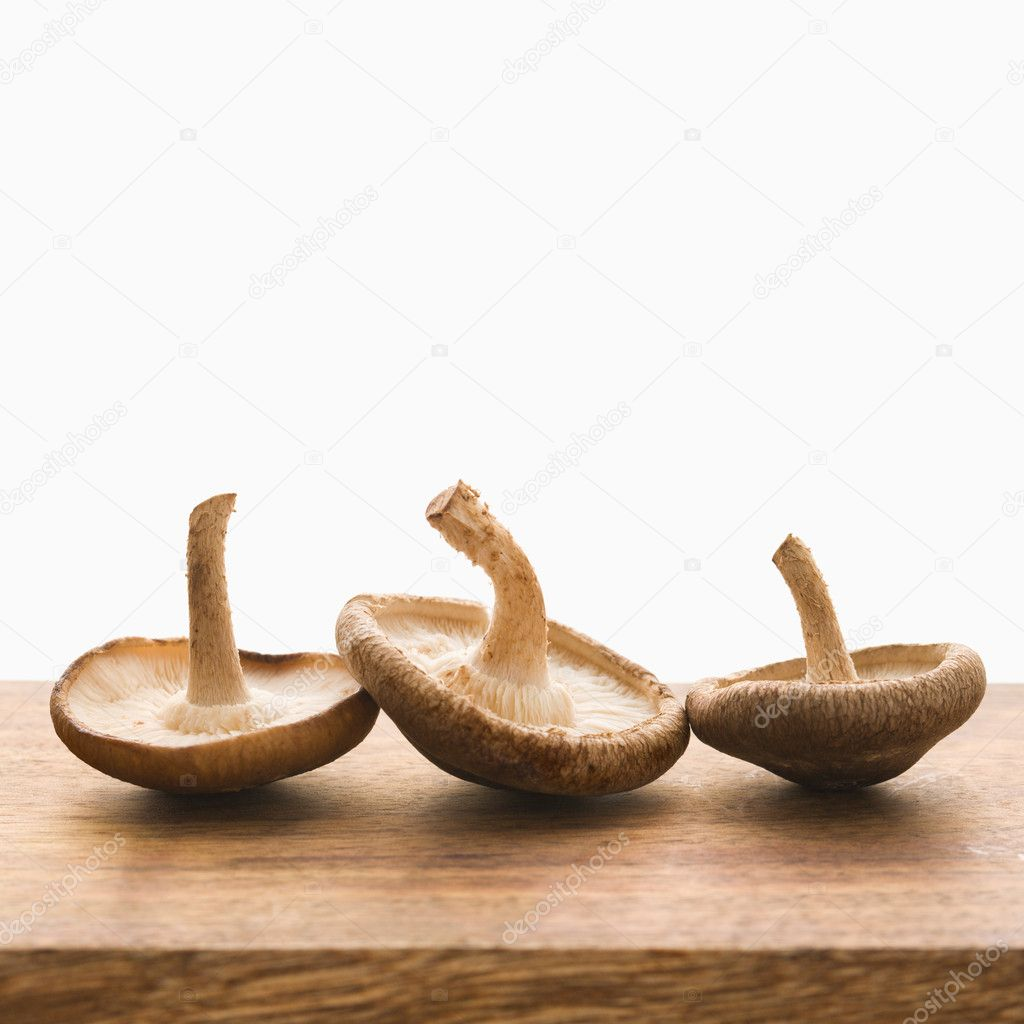 Three brown mushrooms upside down. — Stock Photo #9280997