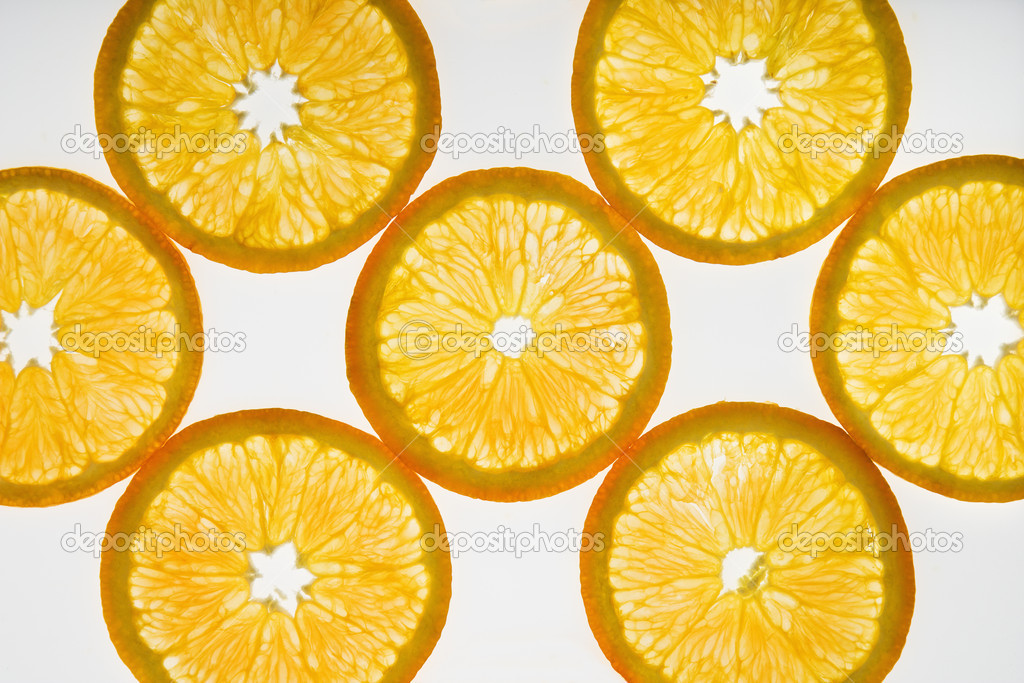 Orange slices on white background.  Stock Photo #9281209