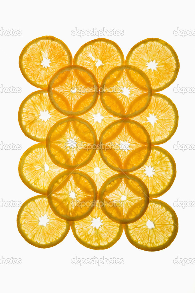 Orange slices arranged in design on white background. — Stock Photo #9281213