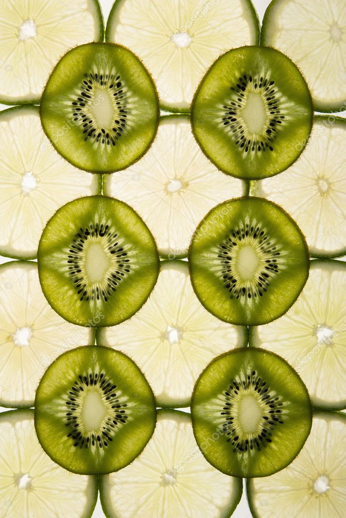 Lime and kiwi fruit slices arranged on white background. — Stock Photo #9281226